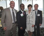 David Josefsberg and Paul Pataky flank honorees Frank Scruggs of Berger Singerman and Edith Osman of Carlton Fields.
