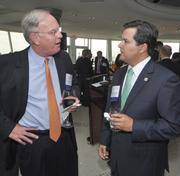Sponsor Craig Grant, Southeast Florida region president of PNC Bank, talks with sponsor Carlos Rodriguez of MassMutual/LINQ Financial.