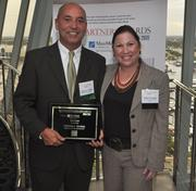 Honoree Octavio Verdeja of Verdeja & DeArmas and Melanie Dickinson, president and publisher of the South Florida Business Journal.