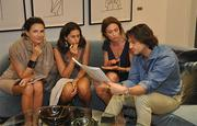 Daniela Bonetti of One Sotheby's, Maria Risi, Carmen Casadella and Velerio Morobito look at diagrams of the project.