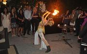 A fire dancer from C&J Productions entertains guests at the broker party.