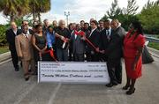 City officials and developers Swerdlow Group and LeFrak Organization cut a ribbon commemorating the long-term lease and development agreement for the Biscayne Landing site.