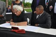 Michael Swerdlow, chairman and CEO of Swerdlow Group and North Miami City Manager Stephen Johnson sign a long-term agreement for the development of the Biscayne Landing site.