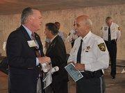 Greater Fort Lauderdale Alliance President and CEO Bob Swindell talks to Broward County Sheriff Al Lamberti.