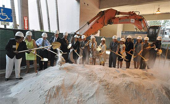 Dignitaries toss sand at the groundbreaking of the new Broward County courthouse.
