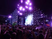 The one and only Deadmau5 (pronounced dead mouse) spins from his massive lit-up cube.