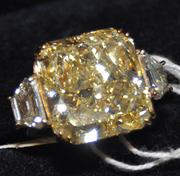 Rothstein's platinum ring, which had a 12.06-carat yellow diamond, sold for $340,000.