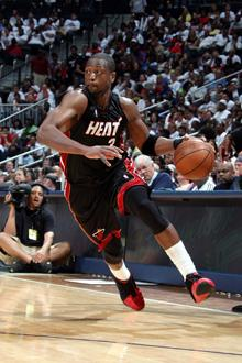 Dwyane Wade and the Miami Heat remained undefeated at home after a 105-100 win over the San Antonio Spurs.