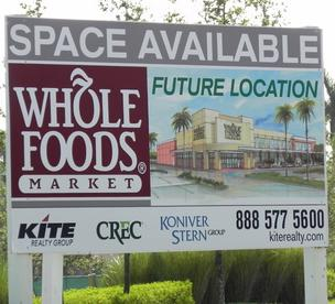 The sign announcing the Whole Foods Market in western Pembroke Pines has been streetside for more than a year.