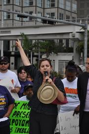 Maria Rodriguez of the Florida Wage Theft Task Force makes a speech about the unpaid wages.