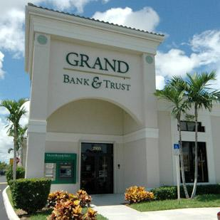 Grand Bank & Trust of Florida improved its capital ratios after selling four branches in the third quarter.