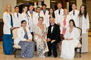 Dr. Morton Levitt (seated, center right) chair of the integrated medical science department and his wife Cynthia (seated, center left) with first and second year medical students at Florida Atlantic University's Charles E. Schmidt College of Medicine.