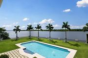 The backyard of the home features an in-ground pool and a view of the Intracoastal Waterway.