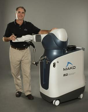 Mako Surgical President and CEO Dr. Maurice R. Ferre with the Robotic Arm Interactive Orthopedic system.
