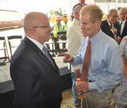Eduardo Padron, president of Miami Dade College, talks with U.S. Sen. Bill Nelson at the project groundbreaking.