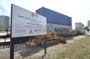 The FEC Railway plans to double stack cargo containers at the Port of Miami and transport them to the Hialeah railyard.