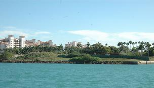 Most of the undeveloped land on Fisher Island is facing foreclosure.