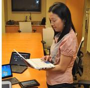 Agnes Kwan of Intel shows the Acer Aspire One netbook.