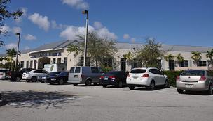 This Deerfield Beach building, home to LA Fitness and offices, is facing foreclosure.
