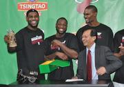 LeBron James, Dwyane Wade and Chris Bosh with the beer mug from Mingbo Sun, president of Tsingtao Brewery Co.