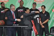 Heat President Pat Riley gives Mingbo Sun his own Heat jersey.