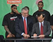 Heat President Pat Riley and Mingbo Sun sign the partnership.
