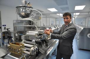Nutri-Force President and CEO Anthony Alfonso explains how a machine forms and fills softgel capsules.