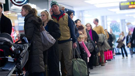 Travelers wait in line at LaGuardia Airport on Dec. 28, 2010. On Feb. 8, more than 2,000 flights to Northeast airports were either canceled or delayed due to Winter Storm Nemo.