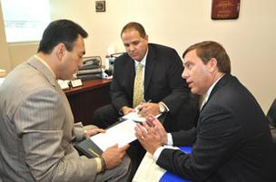 Shawn De Rosa and Robert Polizzi of Northwestern Mutual counsel Miami cardiologist Gilbert Concepcion.