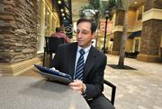 ADT's Steve Shapiro can see what's happening at home using a tablet and one of the company's products.