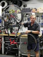 Local bike shop owners say  rising gas prices fuel sales