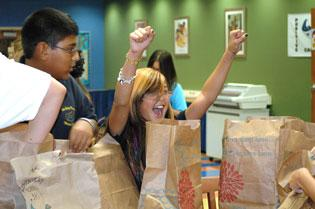 Students at several West Palm Beach schools received back-to-school supplies from Publix shoppers in conjunction with a program by Big Brothers Big Sisters of Martin and Palm Beach Counties.