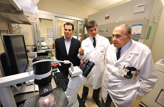 Samuel Reich, Dr. Joshua Hare and Dr. Andrew Schally at the Biomedical Research Building on the campus of the University of Miami Miller School of Medicine.