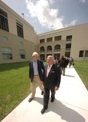 Camillus House Chairman Bob Dickinson with Dr. Paul Ahr, Camillus House president and CEO.