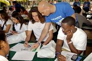 City National Bank of Florida's Mike Xavier works with high school students at a Financial Boot Camp.