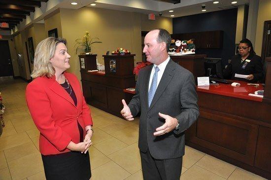 Iberiabank's Jennifer Brancaccio and J. Scott McCleneghen.