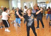Flory Miranda takes a Latin dance class at Leon Medical Center.