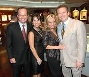 Mark Levinson, Robin Levinson, Kim Rothstein, and Scott Rothstein at a charity event.