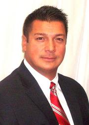 Slaton Risk Services hired Brian Lewis as director of business development.