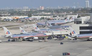 American Airlines has warned of layoffs at its Miami International Airport hub.