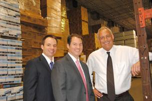 CBRE's David Murphy, Steven McCraney and Scott Melts of Dade Paper at Dade Paper's facility within Orlando Central Park.