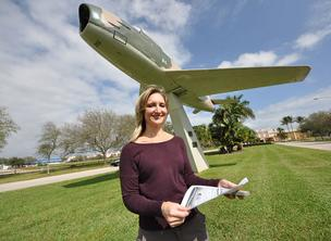Tammi Lyon, chair of the employment committee of veterans assistance group Mission United, stands in front of a war memorial at Holiday Park in Fort Lauderdale.
