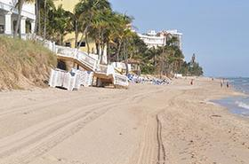 Beach erosion caused damage to the stairway at the Pelican Grand Beach Resort on Fort Lauderdale's beach.