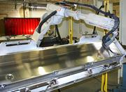 An automated robotic welder assists in the production of missile containers at Gregory Wilson's Precision Metal Industries.
