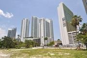 The Genting Group, which plans a four-hotel project on 14 acres next to the Adrienne Arsht Center, has finalized its purchased of both the main and junior debt on the Omni Center in downtown Miami.