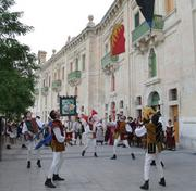 Performers dance at the Valletta Cruise Port in Malta.