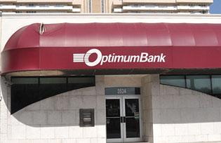 OptimumBank reduced its noncurrent loan ratio to 24.5 percent.