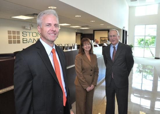 Stonegate Bank CEO David Seleski, CFO Sharon Jones and COO Steve Cameron.