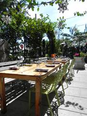 The patio at Sugarcane Raw Bar Grill in Midtown Miami.