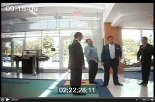 Security camera video shows Scott Rothstein, second from right, preparing to bamboozle an investor at TD Bank's Weston branch.